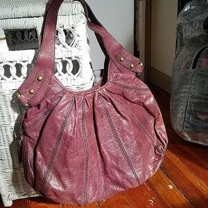 Purple leather fossil bag